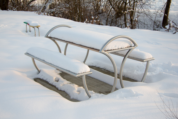 modern metal seating covered with snow
