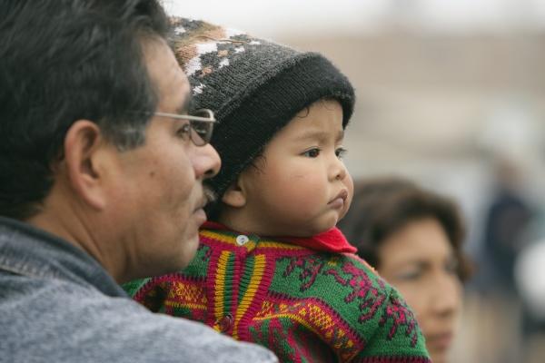 father holding child lima
