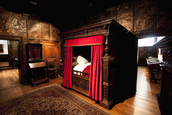 carved oak four poster bed in