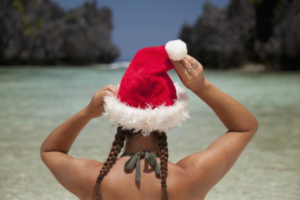a woman tourist wears a santa