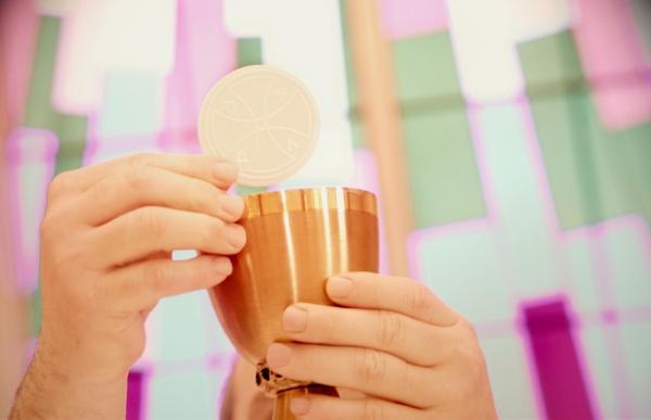priest holds sacraments