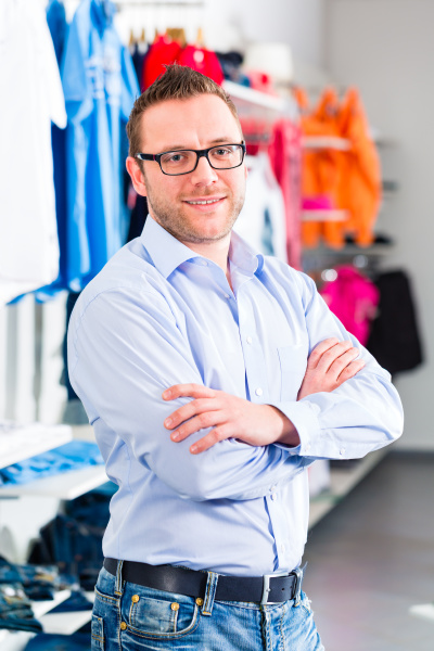 man buying clothes in shop or