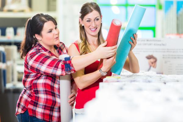 women in home improvement store choosing
