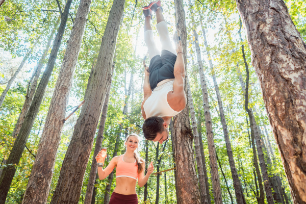 man and woman doing functional fitness