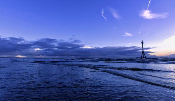 sunset on crosby beach in winter