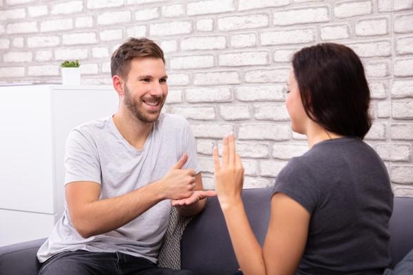 couple communicating with sign language