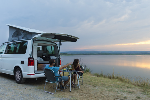 couple having dinner an the camper