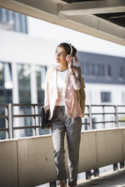 young businesswoman walking in parking garage