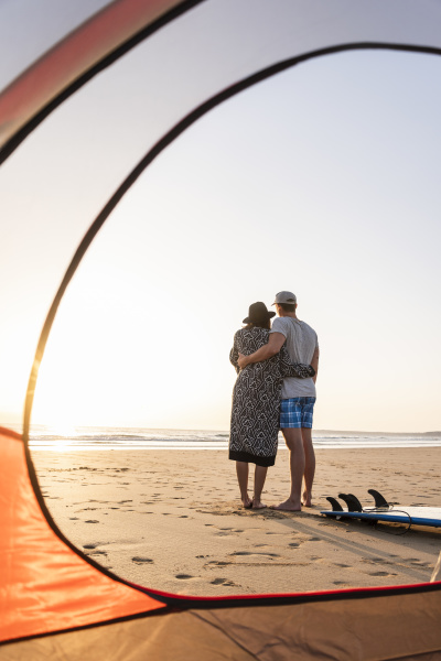 romantic couple camping on the beach