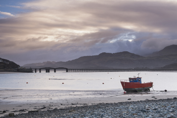 fishing boat and barmouth bridge in