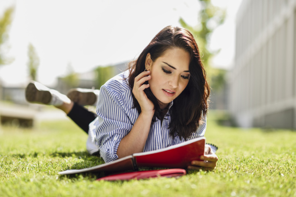 portrait of student lying on lawn