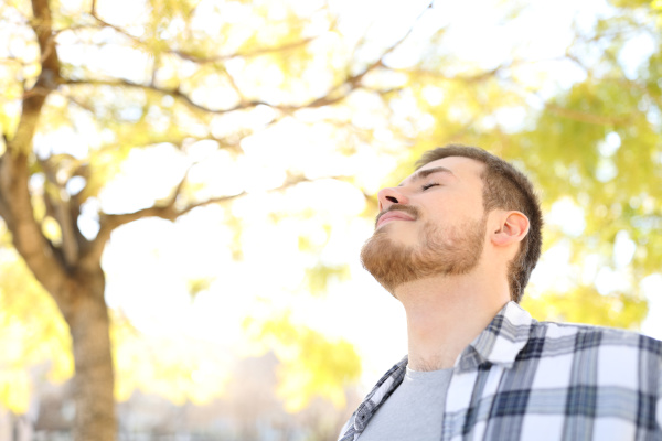 relaxed man is breathing fresh air
