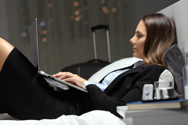 businesswoman working late hours during business
