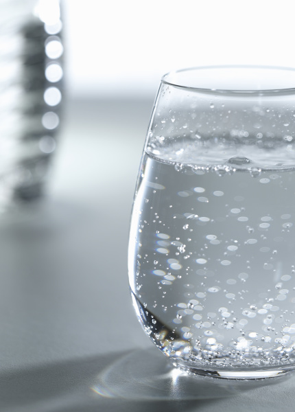 a glass of water with bubbles