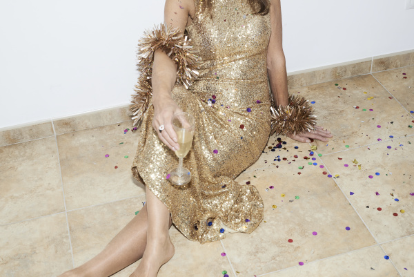 senior woman wearing golden dress