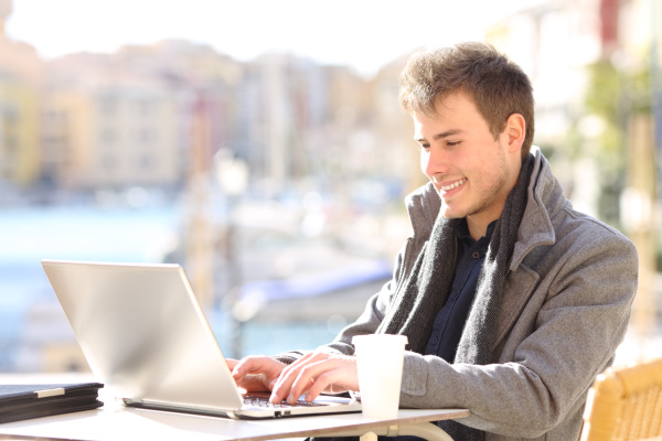 happy man working with a laptop
