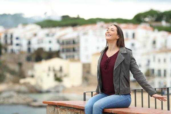 happy woman breathing fresh air on
