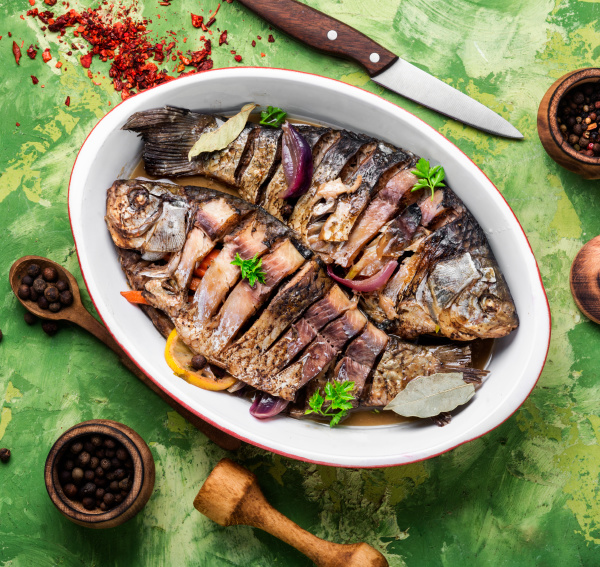 tasty baked fish on plate