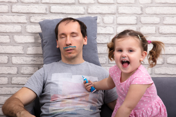 child painting father s face while