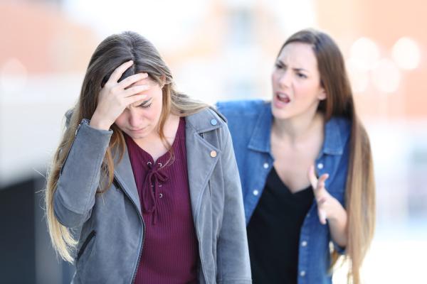 mad girl scolding her concerned friend