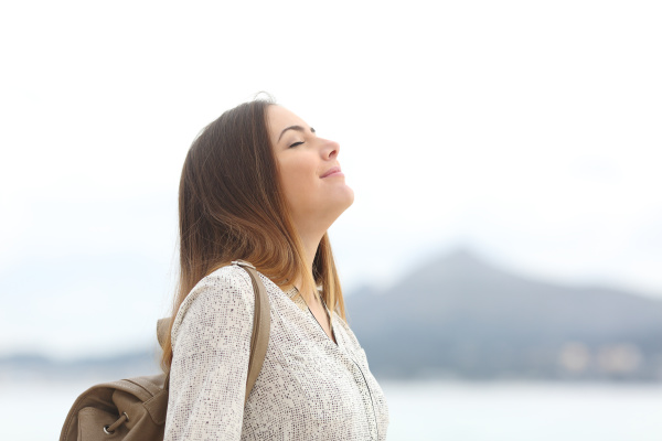 happy woman on the beach breathing