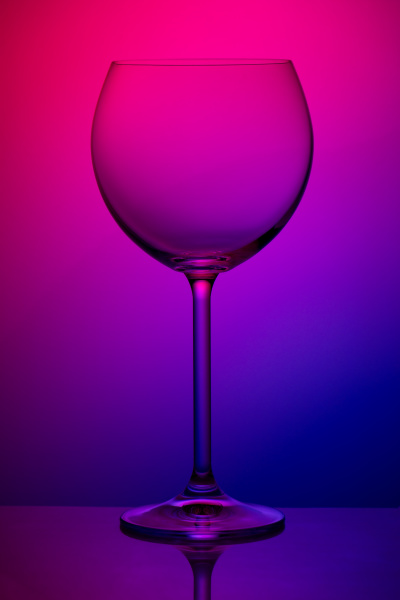 wineglass on colorful background