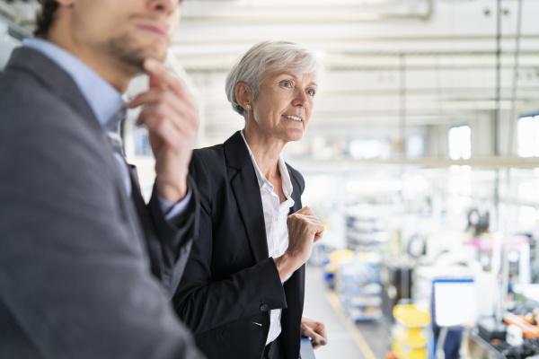 portrait of senior businesswoman with businessman