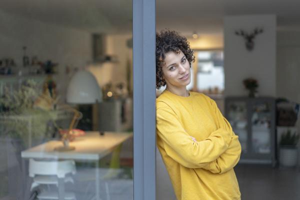 portrait of woman leaning against terrace