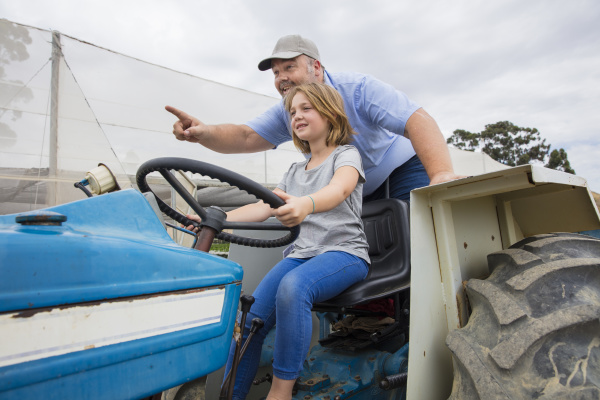 farmer showing his daughter how