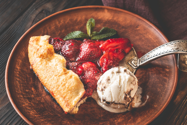 slice of strawberry galette with ice