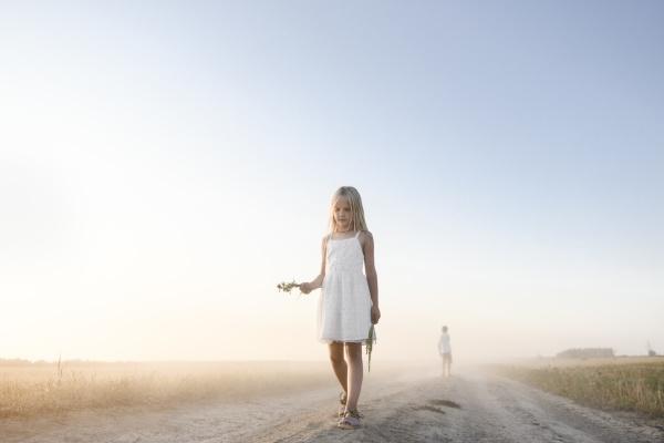 girl walking on a rural dirt