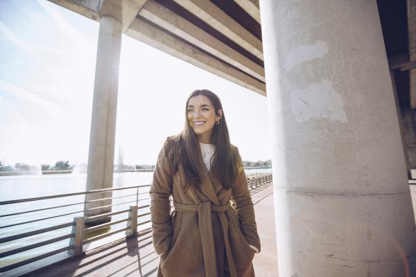 smiling young woman at a lake