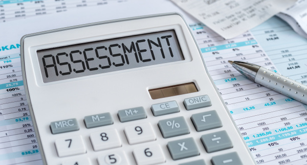 a calculator with the word assessment