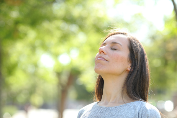 relaxed woman breathing fresh air in
