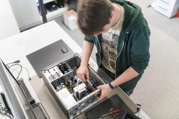 teenager assembling personal computer