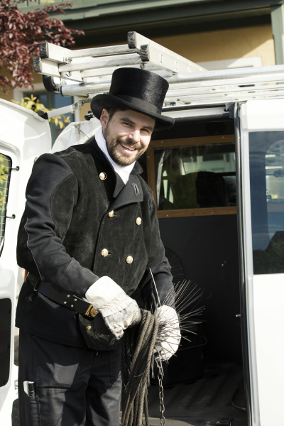 portrait of smiling chimney sweep at