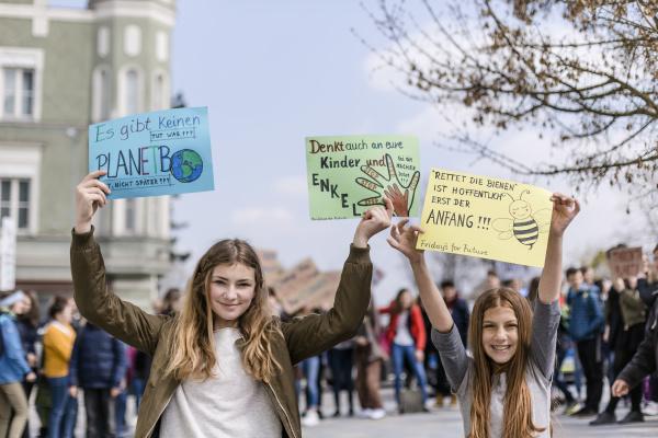 girl holding a placard on a