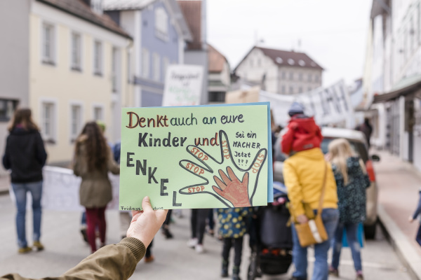 hand holding a placard on a