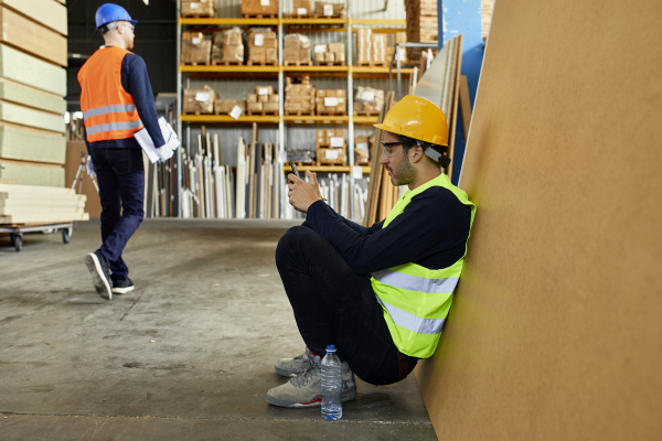 worker using cell phone during a