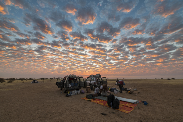 camping under a dramatic morning sky