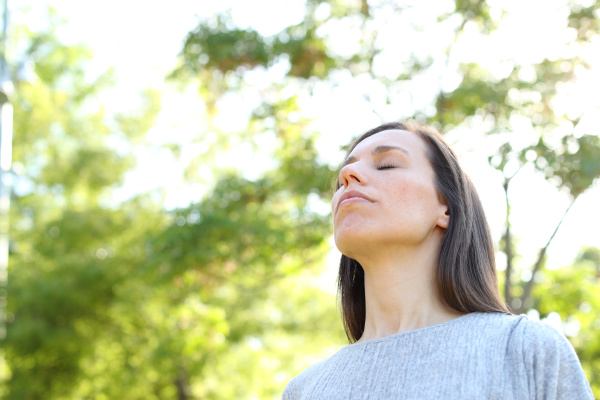 relaxed adult woman breathing fresh air