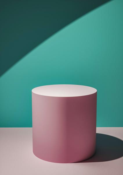 pink circular display plinth against a