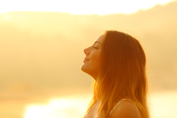 profile of a woman at sunset