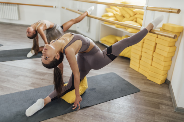 two young women doing barre workout