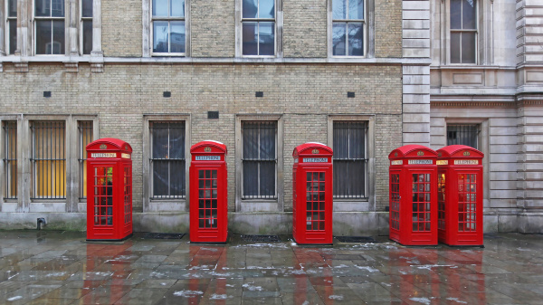 five red telephone boxes