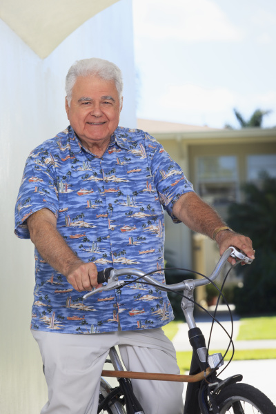 senior man with polio on bicycle
