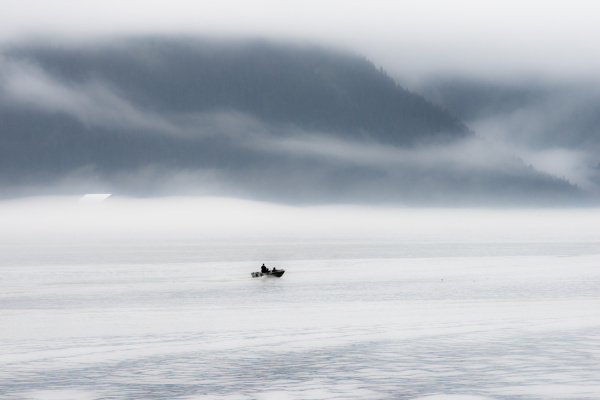 a lone fisher boat heading out