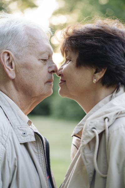 profile of senior couple rubbing noses