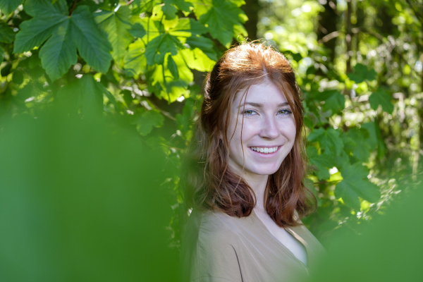 female teenager in a forest