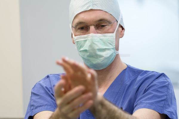 surgeon during surgery disinfecting of